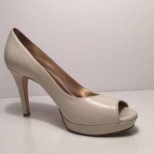 Antonio Melani cream peep toe heels.